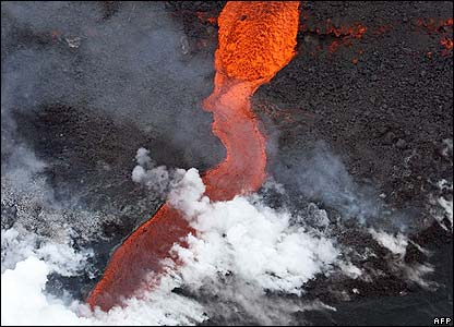 The red hot river of lava has damaged homes and buildings and cut roads in two.