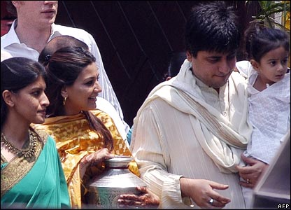 Guests and friends of the Bachchan family including Sonali Bendre (second left) and husband Goldie Behl (right) carry the kalash - ceremonial urn - as part of a pre-nuptial ritual