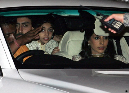 Bollywood star Abhishek Bachchan, second left, his sister Shweta Nanda, right, and her daughter Navya, third left, arrive at 'Prateeksha, the residence of their father and Bollywood star Amitabh Bachc
