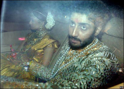 Bollywood actress Aishwarya Rai and Abhishek Bachchan arrive at their wedding celebrations after getting married early on Saturday.