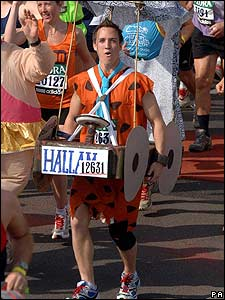 And this man ran it as Fred Flintstone - complete with stone-age car!