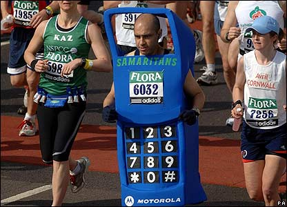 This man chose to race dressed as a mobile phone. He's raising money for the charity Samaritans which helps people who are feeling down.