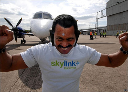 Manjit takes the weight of the plane. He did the task to raise cash for an academy in India.