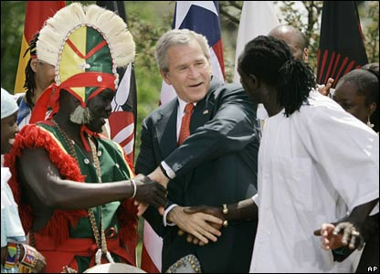 President Bush next joins hands with his fellow dancers. Surely this is the New Year's Eve dance?