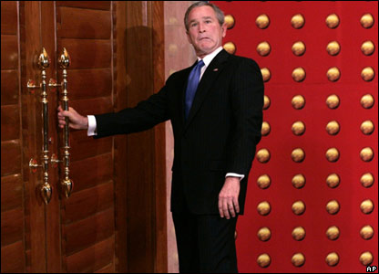 The president pulls a funny face while he tries to open a locked door!