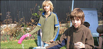Oscar, left, and his friend Tom, practising eel-throwing
