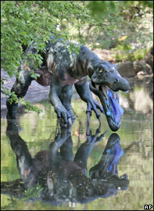 This Baryonyx dino stands by a lake. All the creatures have robotic moving parts.