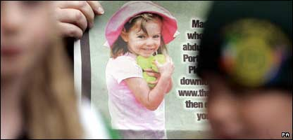 Children hold up a poster of missing Madeleine