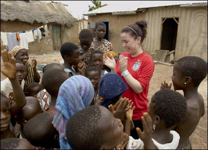 Dani meets some local children during her trip with charities Comic Relief and Action Aid.