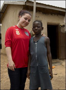 Dani is pictured with Zuwera, 12, who doesn't go to school as she spends her time making money for herself and her nan.