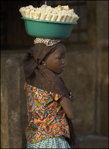 A child carries goods on her head. Great balance!