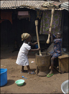 Children help prepare food by using these large sticks and a pot.