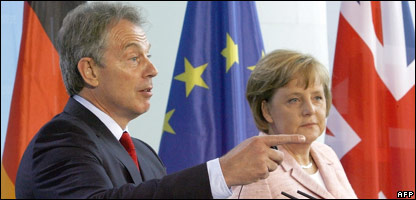 British Prime Minister Tony Blair (L) and German Chancellor Angela Merkel