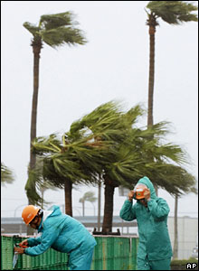 Workers battling against the high winds