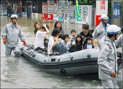 Rescuers helping people to safety