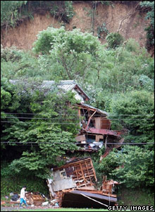 A house that was destroyed by a landslide during the typhoon