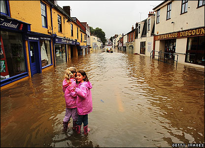 This was the scene in Evesham. In raincoats and waterproof boots, these girls weren't beaten by the floods.