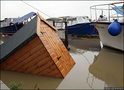 Hang on - that's a funny-looking boat. This shed got swept into the marina by the floods.