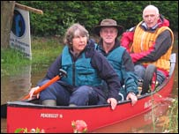 Lauren's dad and their neighbours in a canoe