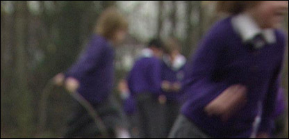 Pupils running in a school playground