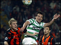Tomas Hubschman (left) and Razvan Rat (right) fight for the ball with Celtic's Jan Vennegoor of Hesselink