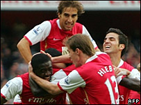 Arsenal players celebrate their first goals