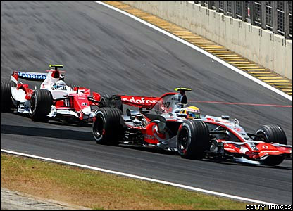 Jarno Trulli (left) is about to overtake Lewis Hamilton
