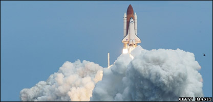 The Space Shuttle Discovery blasts off