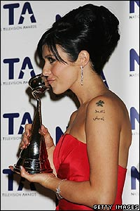 Rival show Corrie didn't miss out. Here's Kym Marsh - who plays Michelle Connor - with her prize for most popular newcomer.