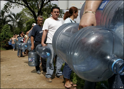 People queuing for clean water