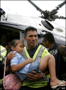 A girl being lifted out of the helicopter that airlifted her away from the floods