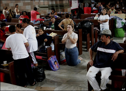 People hit by the floods gather in a church in Mexico