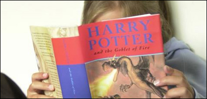 Girl reading Harry Potter book