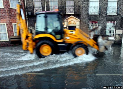 A tractor drives through flooded streets in Great Yarmouth