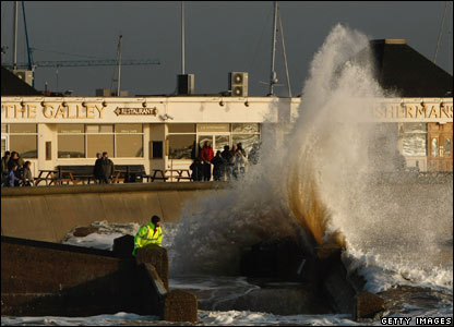 A wave bashes against the sea wall in Lowestoft