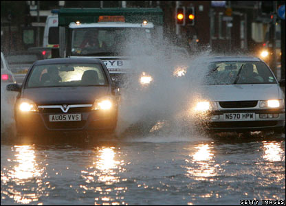 Cars drive through flooded streets in Great Yarmouth