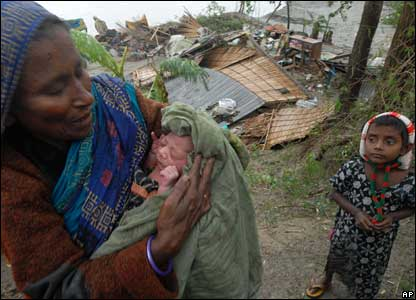 This baby, being cuddled by its grandmother, survived the storm and was named Cyclone.