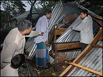 Men help clear up after the storm