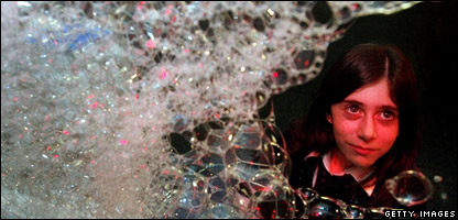 Schoolgirl surrounded by bubbles
