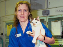 Baby, the bionic cat, with vet Jess Gower