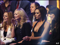 The other Spice Girls watch from the audience
