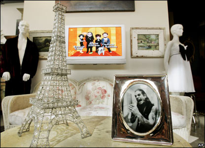 A beaded wire model of the Eiffel Tower and a framed photo of Ozzy Osbourne