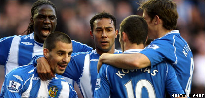 Paul Scharner of Wigan Athletic celebrates with his team mates after scoring an equalising goal