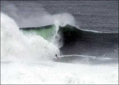 Surfers ride giant waves - Pic by Kelly Allen