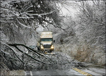 Fallen trees blocking a road during the ice storm.