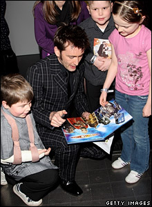 David Tennant signing Dr Who goodies for fans