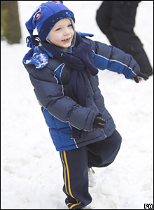 Kid plays in snow