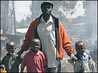A man with his children during one of the riots in Kenya