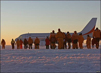 people walking on the ice runway