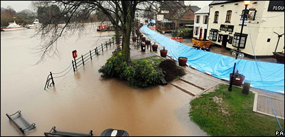 A mobile flood barrier along the burst banks of the river at Upton-upon-Severn, Worcestershire